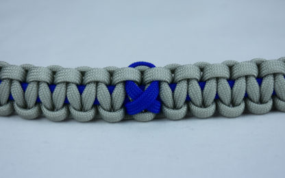 blue and grey anti bullying paracord bracelet with blue ribbon in the center