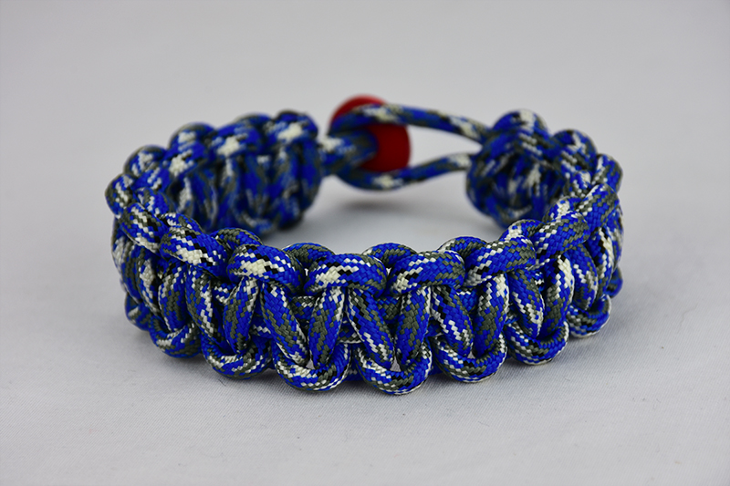 blue camouflage paracord bracelet unity band with red button in back, picture of a blue camouflage paracord bracelet unity band with red button fastener in the back on a white background