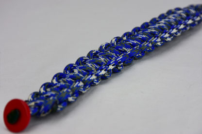 blue camouflage paracord bracelet unity band with red button in the corner, picture of a blue camouflage paracord bracelet unity band with red button fastener in the front corner