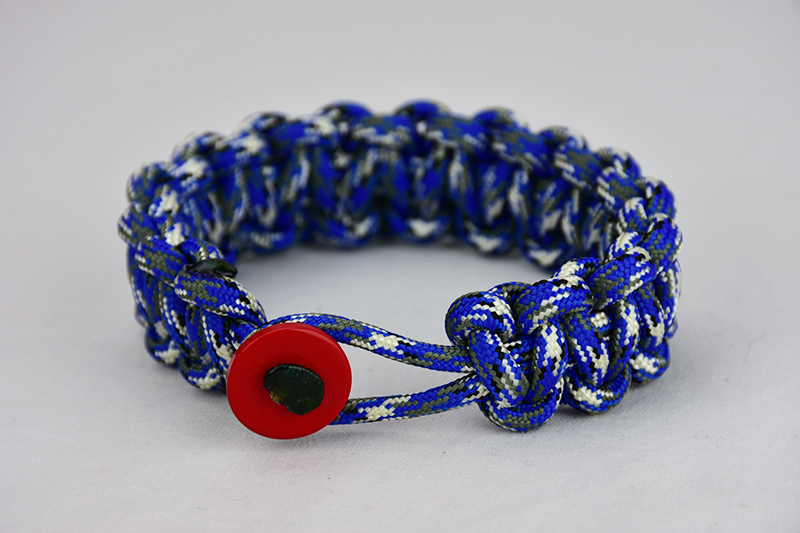 blue camouflage paracord bracelet unity band with red button on front, picture of a blue camouflage paracord bracelet unity band with red button fastener in front on a white background
