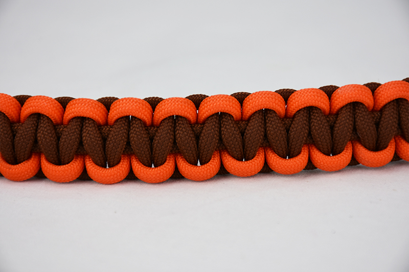 brown orange and brown paracord bracelet unity band across the center of a white background