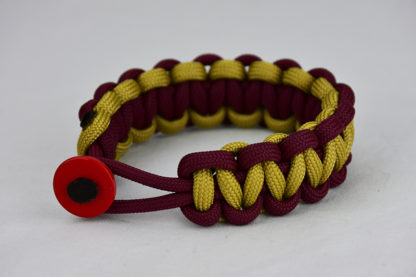 burgundy burgundy and gold paracord bracelet unity band with red button in the front, picture of a burgundy burgundy and gold paracord bracelet unity band with red button fastener in the front on a white background