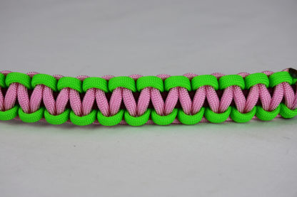 burgundy neon green and soft pink paracord bracelet unity band across the center of a white background
