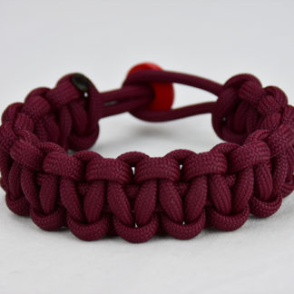 burgundy paracord bracelet unity band with red button in back, picture of a burgundy paracord bracelet with red button fastener in the back and on a white background