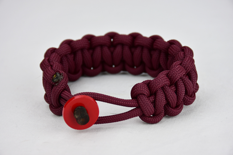 burgundy paracord bracelet unity band with red button in front, picture of a burgundy paracord bracelet unity band with red button fastener