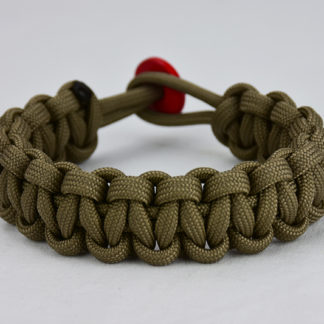 coyote brown paracord bracelet unity band with red button, picture of a coyote brown paracord bracelet with a red button fastener in the back