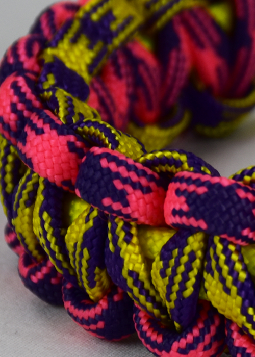 custom multi color paracord bracelets, picture of a pink and purple camouflague purple and yellow camouflage and neon yellow paracord bracelet unity band with red button