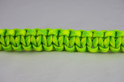 dayglow camouflage paracord bracelet across the center of a white background