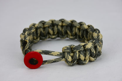 desert sand foliage camouflage paracord bracelet with red button in the front, picture of a desert sand foliage camouflage paracord bracelet with red button fastener in the front on a white background