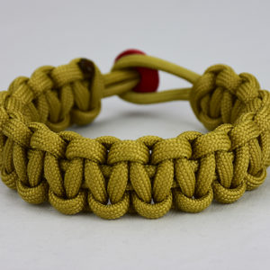 gold paracord bracelet unity band with red button in back