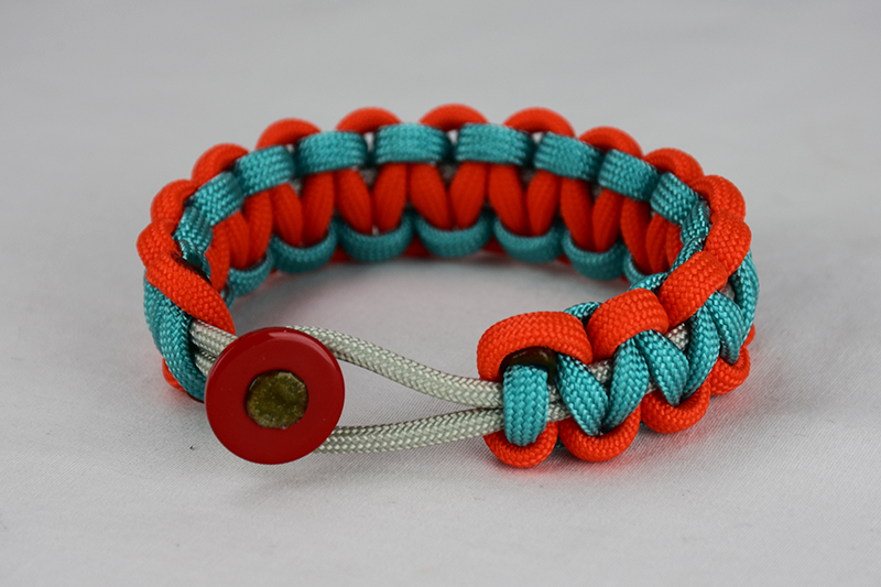 grey orange and teal paracord bracelet unity band with red button fastener in the front on a white background