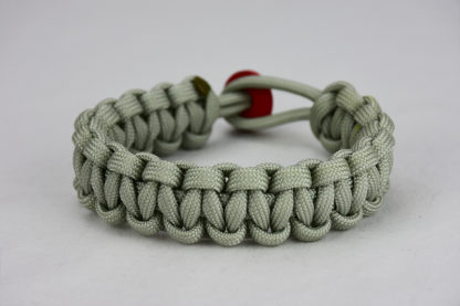 grey paracord bracelet with red button, picture of a grey paracord bracelet with red button fastener on a white background