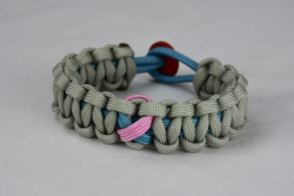 light blue and grey sids support paracord bracelet unity band with red button back, picture of a light blue and grey sids support paracord bracelet with red button fastener on a white background