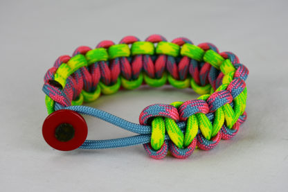 light blue pink and light blue camouflage and dayglow camouflage paracord bracelet with red button in front