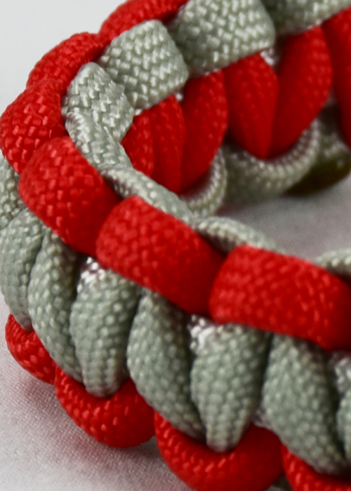 multi color paracord bracelet with red grey and white paracord unity band
