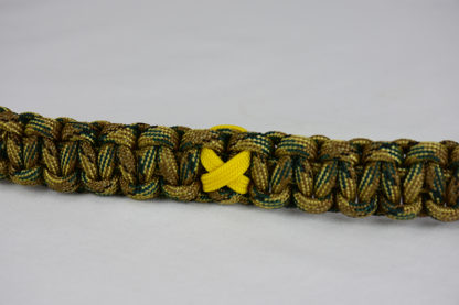 multicam camouflage military support paracord bracelet with yellow ribbon in the center of a white background