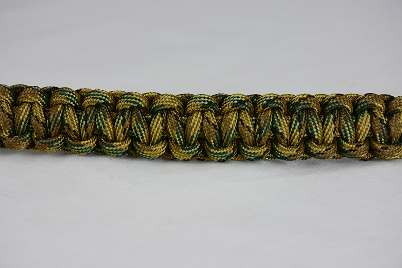 multicam camouflage paracord bracelet unity band across the center of a white background