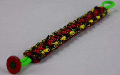 neon green black and yellow camouflage red and black camouflage rasta paracord bracelet with red button corner