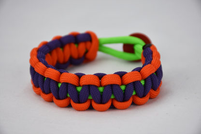 neon green orange purple paracord bracelet with red button in the back