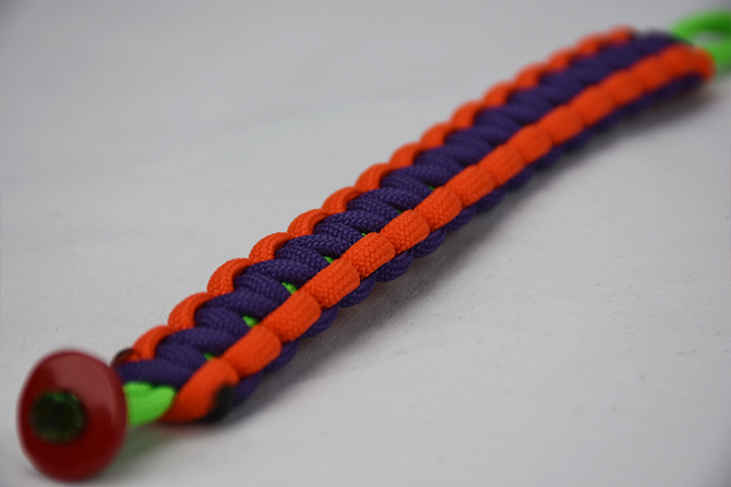 neon green orange and purple paracord bracelet unity band with red button in the bottom corner