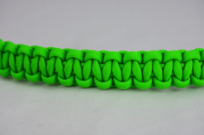 neon green paracord bracelet unity band across the center of a white background