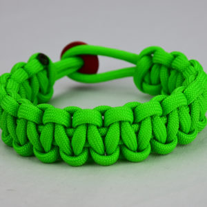 neon green paracord bracelet unity band with red button in back, picture of a neon green paracord bracelet unity band with red button fastener in the back on a white background