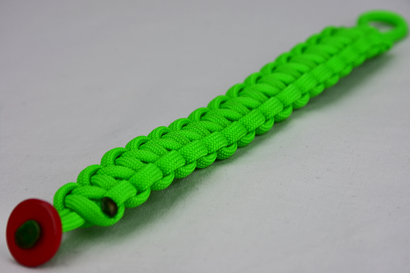 neon green paracord bracelet unity band with a red button in the front corner
