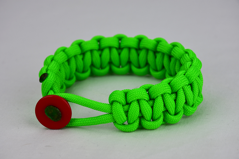 neon green paracord bracelet unity band with red button in front, picture of a neon green paracord bracelet unity band with red button in front with a red button fastener