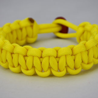 neon yellow paracord bracelet unity band with red button in the back