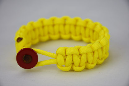 neon yellow paracord bracelet unity band with red button in the front