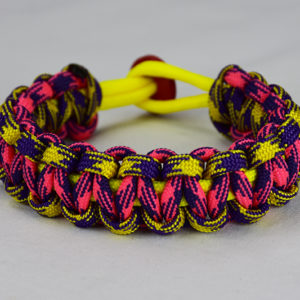 neon yellow purple and yellow camouflage pink and purple camouflage paracord bracelet unity band with red button back, picture of a neon yellow purple and yellow camouflage pink and purple camouflage paracord bracelet unity band with red button fastener