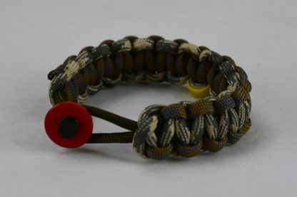 od green desert foliage camouflage desert sand foliage camouflage military support paracord bracelet with red button in front and yellow ribbon