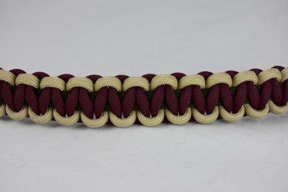 od green desert sand and burgundy paracord bracelet across the center of a white background