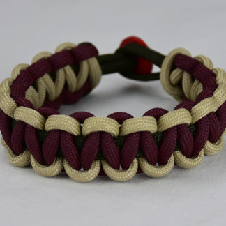 od green desert sand and burgundy paracord bracelet unity band with red button in the back, picture of an od green desert sand and burgundy paracord bracelet unity band with red button fastener in back on a white background