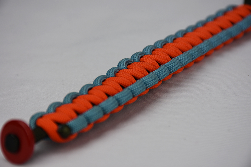 od green light blue and orange paracord bracelet with red button in the corner, picture of an od green light blue and orange paracord bracelet with red button fastener on a white background