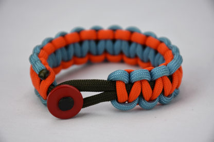 od green light blue and orange paracord bracelet with red button in front, picture of a od green light blue and orange paracord bracelet unity band with red button fastener in the front on a white background