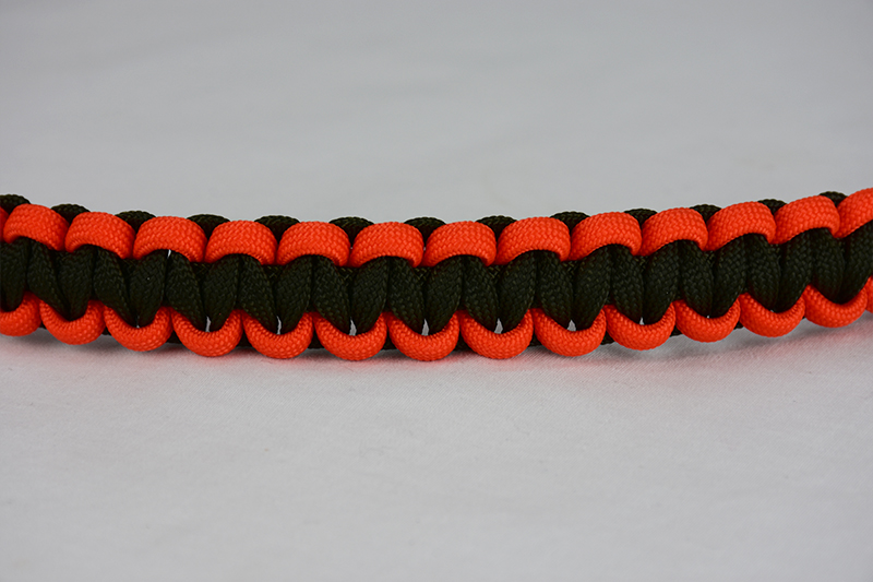 od green orange and od green paracord bracelet unity band across the center of a white background