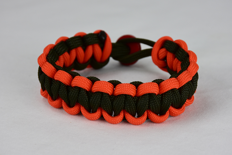 od green orange and od green paracord bracelet unity band with red button back, picture of an od green orange and od green paracord bracelet unity band with red button fastener on a white background