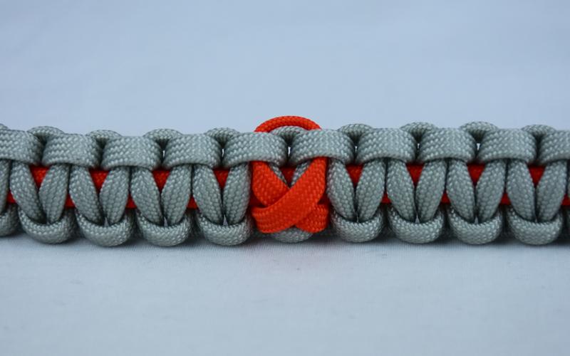 orange and grey leukemia support paracord bracelet with orange ribbon center