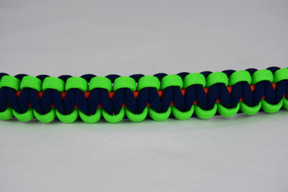 orange neon green and navy blue paracord bracelet unity band across the center of a white background