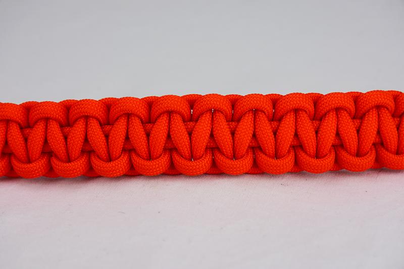 orange paracord bracelet unity band, picture of an orange paracord bracelet across the center