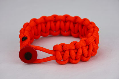 orange paracord bracelet unity band with red button in the front, picture of an orange paracord bracelet unity band with red button