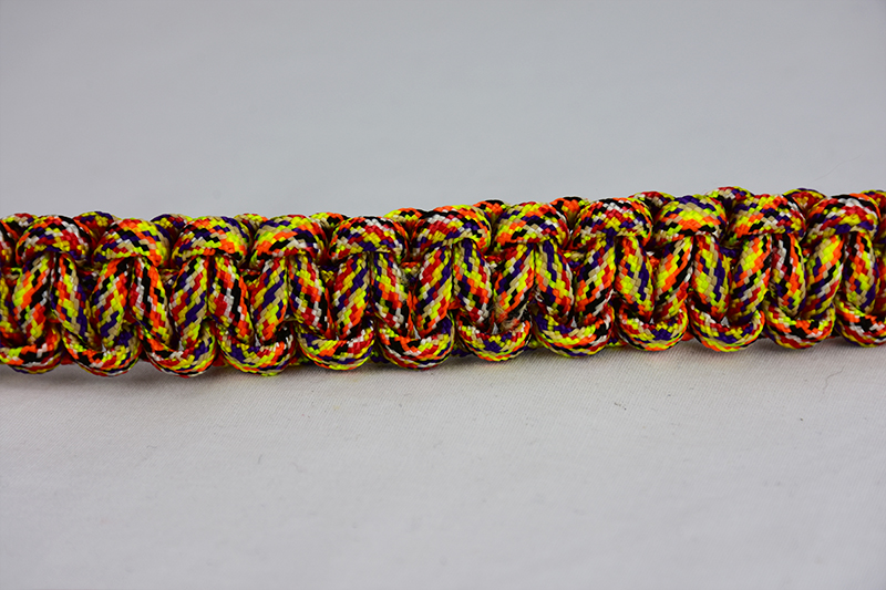 overkill camouflage paracord bracelet unity band across the center of a white background