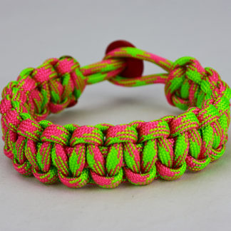 pink and neon green camouflage paracord bracelet unity band with red button, picture of a pink and neon green camouflage paracord bracelet unity band with red button fastener in the back on a white background
