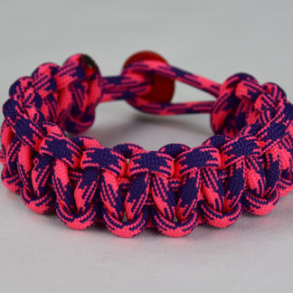 pink and purple camouflage paracord bracelet unity band with red button back, picture of a pink and purple camouflage paracord bracelet with red button fastener in the back on a white background