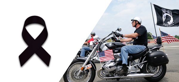 pow mia black support ribbon, pow mia support, bracelets for a cause, picture of a guy riding a motorcycle with a pow mia flag and america flag waving from the back