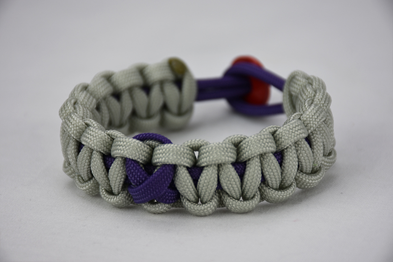 purple and grey alzheimers support paracord bracelet unity band with purple ribbon and red button, picture of a purple and grey alzheimers support paracord bracelet with red button fastener in the back