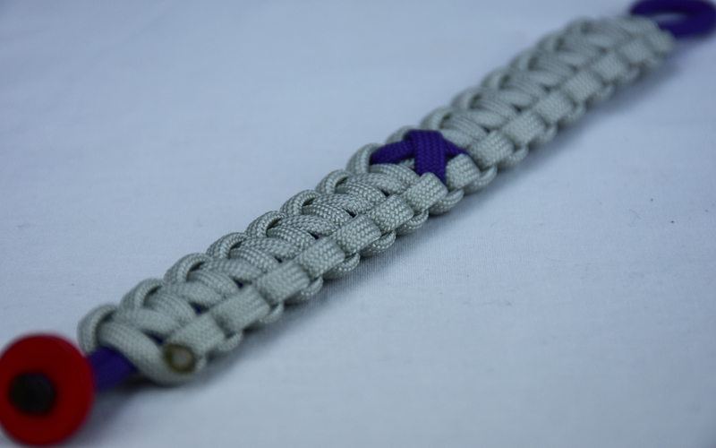 purple and grey alzheimers support paracord bracelet with red button corner and purple ribbon