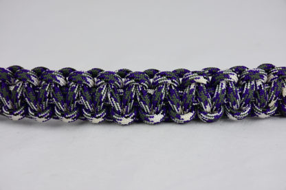 purple camouflage paracord bracelet unity band across the center of a white background