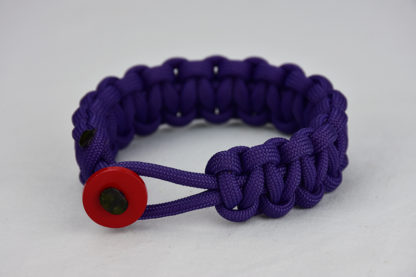 purple paracord bracelet with red button in the front, picture of a purple paracord bracelet unity band with red button fastener in the front